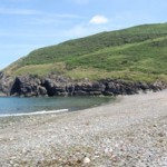 Cwm Tydu Beach with path on headland to New Quay